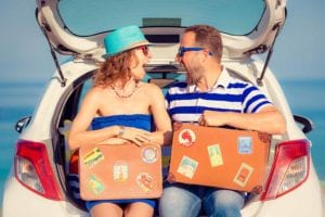 Happy Couple Travel By Car